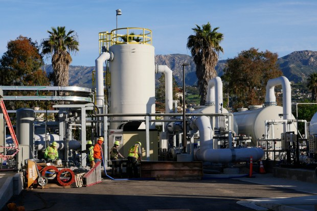 Workers prepare a desalination plant for service at the Charles Meyer Desalination Facility Friday, Feb. 24, 2017, in Santa Barbara, Calif. Plans call for the facility to be producing drinkable water by April, 2017. (Jim Gensheimer/Bay Area News Group)