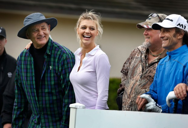 From left, actor Bill Murray, model Kelly Rohrbach, comedian Larry the Cable Guy and musician Kenny G wait to tee off on the 1st hole during the AT&T Pro-Am Celebrity Challenge at Pebble Beach Golf Links in Pebble Beach, Calif., Wednesday, Feb. 8, 2017. (Patrick Tehan/Bay Area News) Group)
