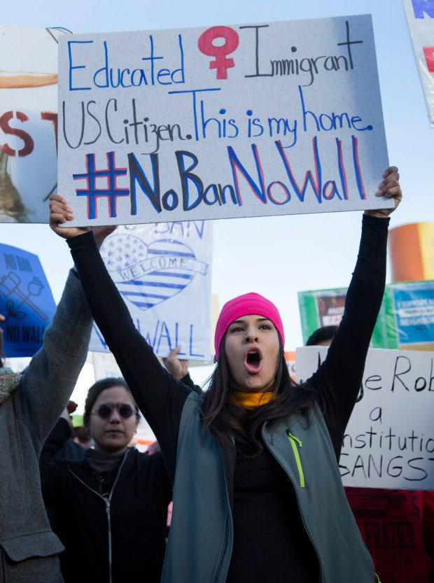 Marisol Perez, of Walnut Creek, and other protestors attend the #NoBanNoWall rally at San Francisco Civic Center Plaza in San Francisco, Calif., Saturday, Feb. 4, 2017. Bay Area people were demonstrating against Trump's immigration and refugee policies. (Patrick Tehan/Bay Area News) Group)