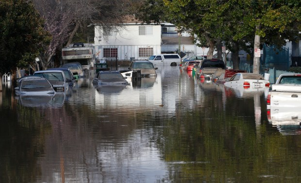 Flood waters slowly recede on Nordale Ave. Wednesday, Feb. 22, 2017, in San Jose, Calif. (Jim Gensheimer/Bay Area News Group)
