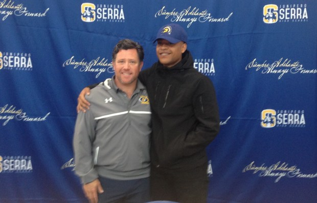 Serra senior Leki Nunn, right, poses with his football coach Patrick Walsh during a ceremony inside the gym in San Mateo. (Vytas Mazeika / Bay Area News Group)