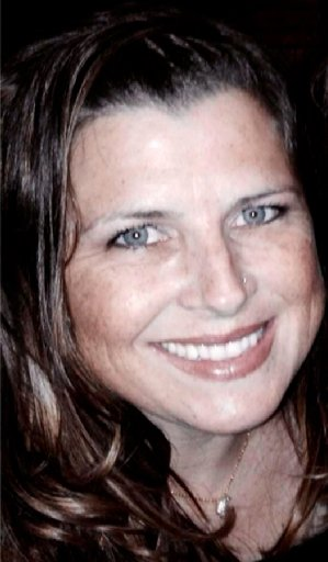 In this undated file photo released by the Singh family shows Misty Holt Singh, who was taken hostage and killed in Stockton, Calif., on July 16, 2014, following a bank robbery and gun battle. Police say the hostage who died during a bank robbery and chase in Northern California was killed by police, not the suspects. Stockton Police Chief Eric Jones said Monday, Aug. 11, 2014, that the results of a preliminary ballistics report show that Stockton police fired the bullet or bullets that killed 41-year-old Misty Holt-Singh. (AP Photo/Singh Family, File)