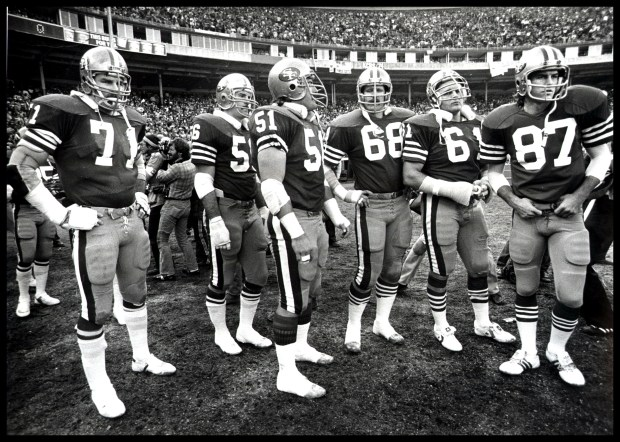 Photo of a the offensive team of the 1981 49ers ready to take the field at Candlestick Park in San Francisco Calif. during the 1981 season where they won their first Super Bowl. Pictured from Left to right is #71 Keith Fahnhorst, #56 Fred Quillan, #51 Randy Cross, #68 John Ayers, #61 Dan Audick, and #87 Dwight Clark. (DAN ROSENSTRAUCH/ CONTRA COSTA TIMES)