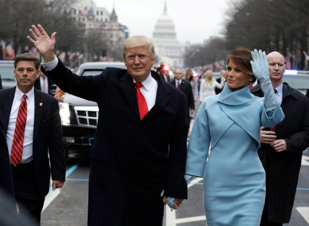 WASHINGTON, DC - JANUARY 20: U.S. President Donald Trump waves to supporters along the parade route with first lady Melania Trump and son Barron Trump after being sworn in at the 58th Presidential Inauguration January 20, 2017 in Washington, D.C. Donald J. Trump was sworn in today as the 45th president of the United States (Photo by Evan Vucci - Pool/Getty Images)