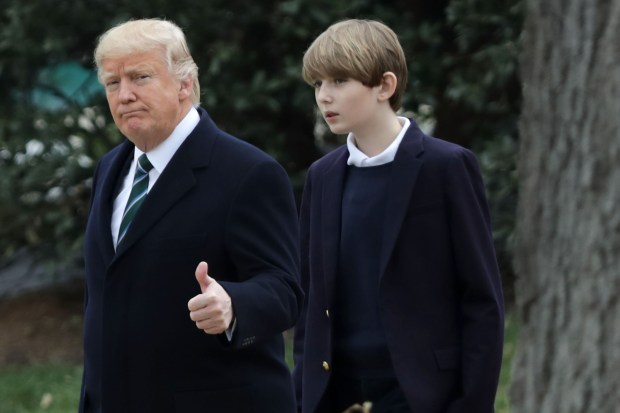 U.S. President Donald Trump and his son Barron Trump depart the White House March 17, 2017 in Washington, DC. The first family is scheduled to spend the weekend at their Mar-a-Lago Club in Palm Beach, Florida.  (Photo by Chip Somodevilla/Getty Images)