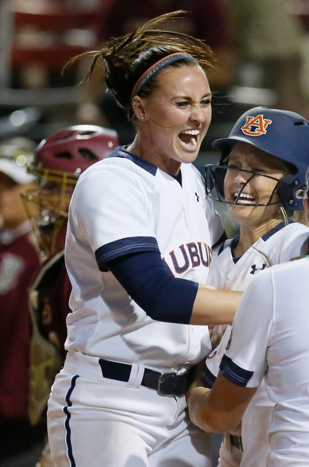 FILE - In this June 5, 2016, file photo, Auburn infielder Haley Fagan, left, and outfielder Morgan Podany celebrate Podany's game winning run against Florida State in the eighth inning of an NCAA Women's College World Series softball game in Oklahoma City. Florida softball coach Tim Walton was involved in an altercation with Auburn shortstop Haley Fagan on Monday night, March 27, 2017, after Walton gave Fagan a slight push during postgame handshakes. (AP Photo/Sue Ogrocki, File)