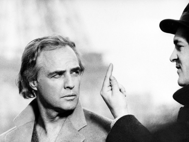 "US actor Marlon Brando is directed 05 March 1972 in Paris during the filming of ""Last tango in Paris"" by Italian writer-director Bernardo Bertolucci (R). Marlon Brando died in Los Angeles on Thursday 1st July 2004 at the age of 80. AFP PHOTO (Photo credit should read /AFP/Getty Images)"