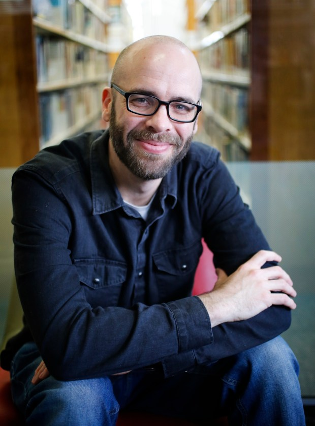 """Author Zach Wyner poses for a photo at the Rockridge Branch Library in Oakland, Calif., on Thursday, March 9, 2017. Wyner has just published his debut novel, """"What We Never Had"""". (Laura A. Oda/Bay Area News Group)"""