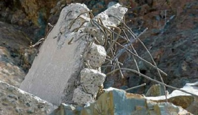 Debris of rebar and concrete from the damaged main Lake Oroville spillway, seen on March 14. (Kelly M. Grow — California Department of Water Resources)
