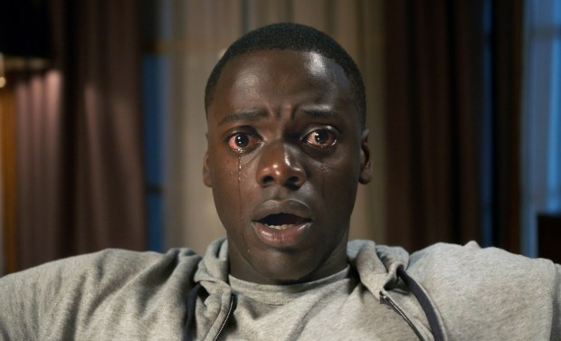"This image released by Universal Pictures shows Daniel Kaluuya in a scene from, ""Get Out."" Jordan Peele's thriller sensation ""Get Out"" crossed $100 million over the weekend, reaching that milestone in just 16 days. It's a staggering result for a film that, though it cost less than $5 million to make, has become a cultural sensation. (Universal Pictures via AP)"