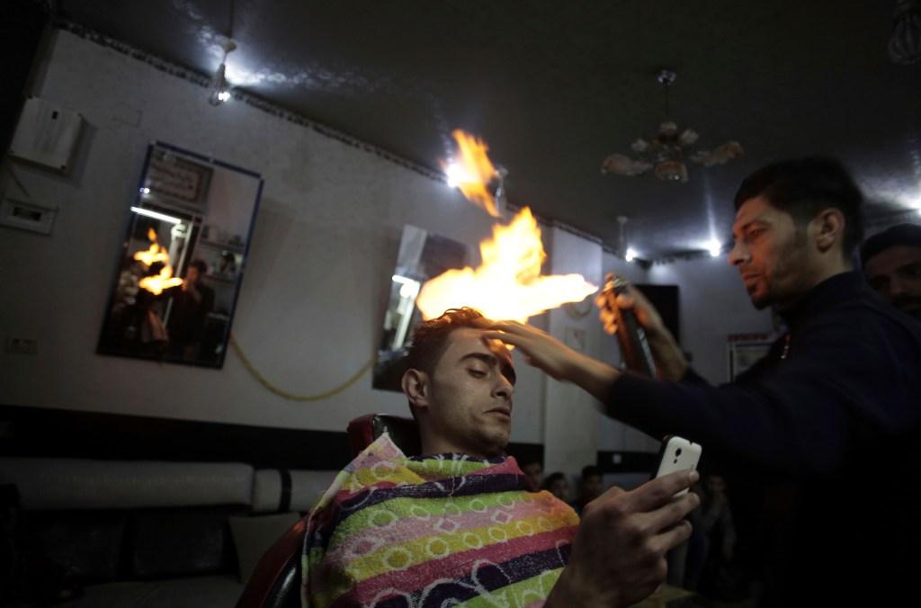 gaza barber sets customers' hair