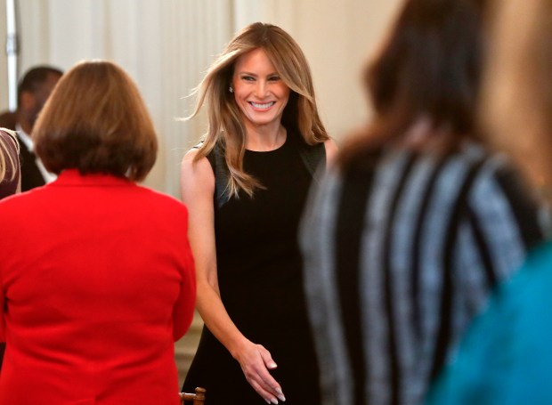 In this March 8, 2017, photo, first lady Melania Trump arrives in the State Dining room of the White House in Washington, where she hosted a luncheon on International Women's Day. Being first lady of the United States likely was not a life goal that Melania Trump considered while growing up in her native Slovenia. But after weeks out of the public eye following Donald Trump's swearing-in as president, she has begun to embrace her new, more public role. (AP Photo/Pablo Martinez Monsivais)