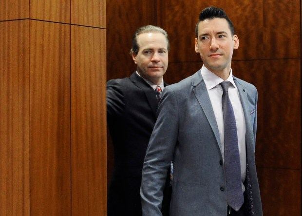 FILE - In this April 29, 2016 file photo, David Robert Daleiden, right, leaves a courtroom after a hearing in Houston. California prosecutors say two anti-abortion activists who made undercover videos of themselves trying to buy fetal tissue from Planned Parenthood have been charged with 15 felony counts of invasion of privacy. State Attorney General Xavier Becerra announced the charges Tuesday, March 28, 2017, against Daleiden and Sandra Merritt. (AP Photo/Pat Sullivan, File)