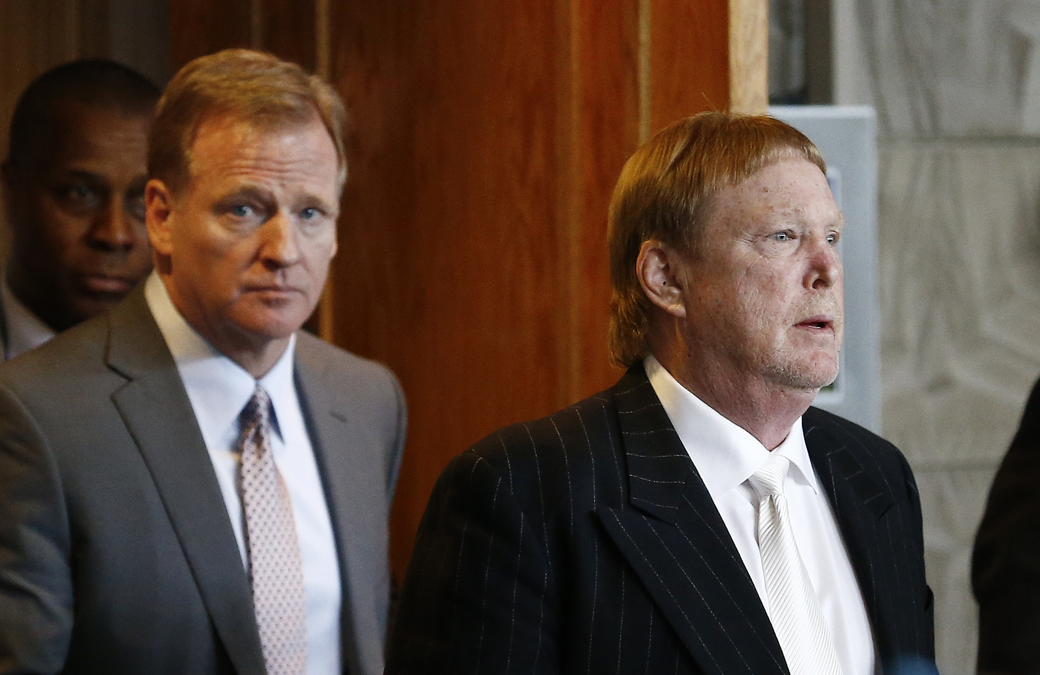 Oakland Raiders owner Mark Davis right emerges from the NFL football annual meetings with NFL Commissioner Roger Goodell left after owners approved the move of the Raiders to Las Vegas Monday
