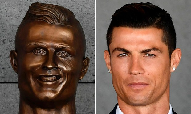 The bust, and the real Ronaldo. (AFP Getty)
