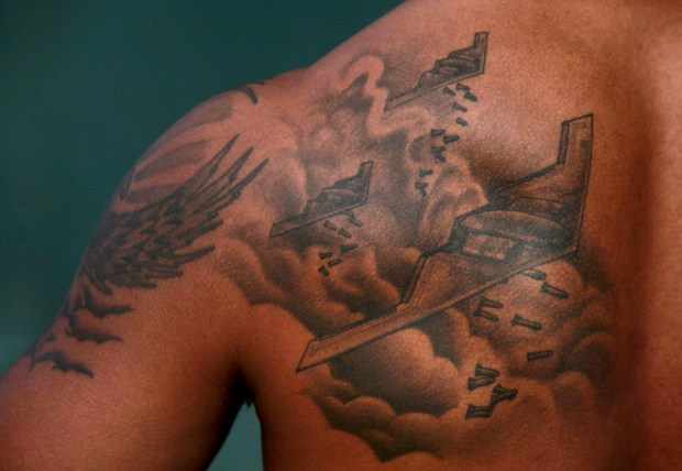 Oakland Athletics outfielder Khris Davis shows off his back tattoo of a B2 Stealth Bomber, Sunday, Feb. 26, 2017, during Spring Training camp at Hohokam Stadium in Mesa, Az. (Karl Mondon/Bay Area News Group)