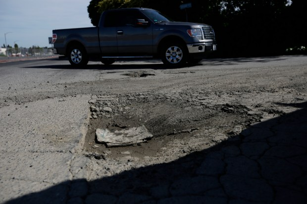 Deep potholes on Stone Ct. off Villa Stone Drive which is in bad need of road-repairs in San Jose, Calif., on Wednesday, March 29, 2017. (Josie Lepe/Bay Area News Group)