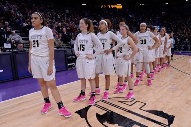Archbishop Mitty's Tahlia Garza (21) and her teammates wait to shake hands with Clovis West after losing the girls Open Division CIF state basketball championship game at Golden 1 Center in Sacramento, Calif. on Saturday, March 25, 2017. Clovis West defeated Archbishop Mitty 44-40. (Jose Carlos Fajardo/Bay Area News Group)