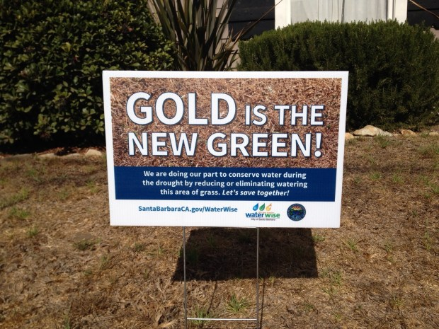A water conservation sign is shown placed on a dried up lawn on October 14, 2014 in Santa Barbara, Calif. (Courtesy of City of Santa Barbara)