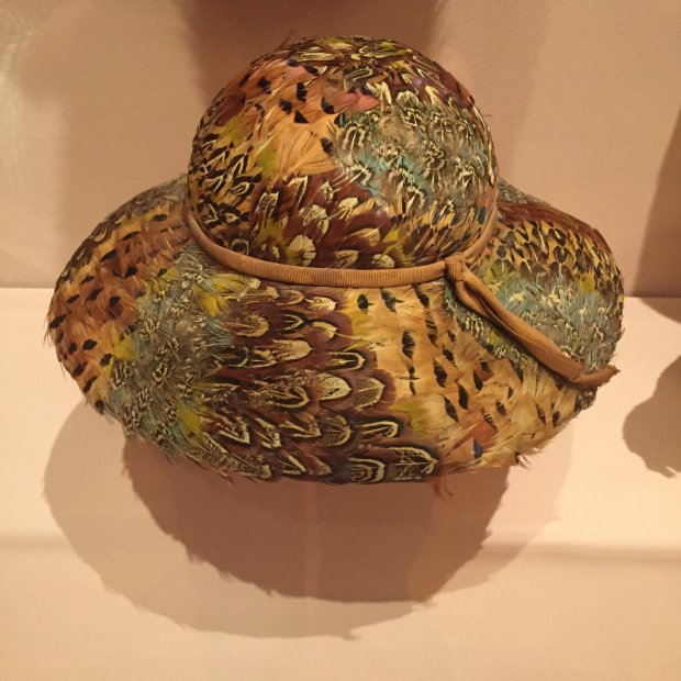 """A colorful hat made out of pheasant feathers is among the displays at""""Fashion to Die For: A Shopper's Dilemma,"""" a new exhibition at History Park in San Jose that opened March 19, 2017. (Sal Pizarro/Staff)"""