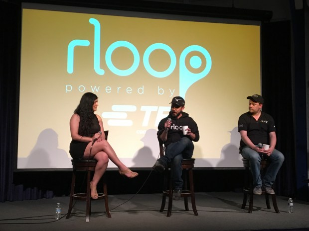 RLoop team members Brent Lessard, center, and Thomas Lambot, right, attend an undated panel discussion on its Hyperloop vehicle prototype. (Courtesy of rLoop)