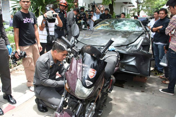Sept. 3, 2012: A Ferrari that was driven by Vorayuth Yoovidhyaand a motorcycle, both involved in an accident, are displayed by police in Bangkok, Thailand. (Thai Daily News via AP)
