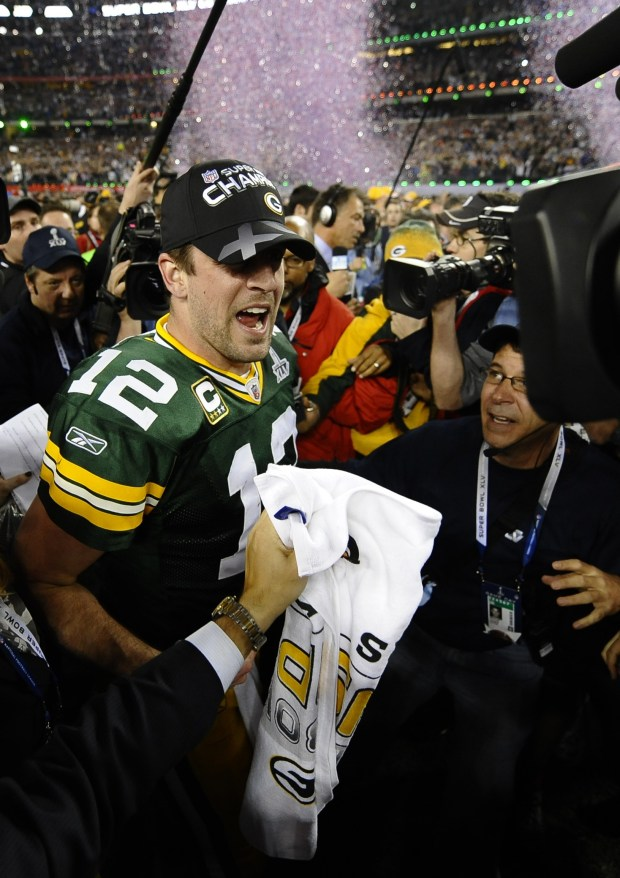 Aaron Rodgers #12 of the Green Bay Packers speaks to the press after winning Super Bowl XLV at Cowboys Stadium on February 6, 2011, in Arlington, Texas. AFP PHOTO / TIMOTHY A. CLARY (Photo credit should read TIMOTHY A. CLARY/AFP/Getty Images)