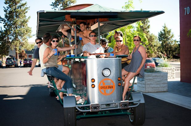 There are several ways to tour the beer scene in Bend, Oregon. You can take a horse-drawn wagon tour, ride a van tour or board the Cycle Pub and pedal for that brew.(Byron Roe Photography/Visit Bend)