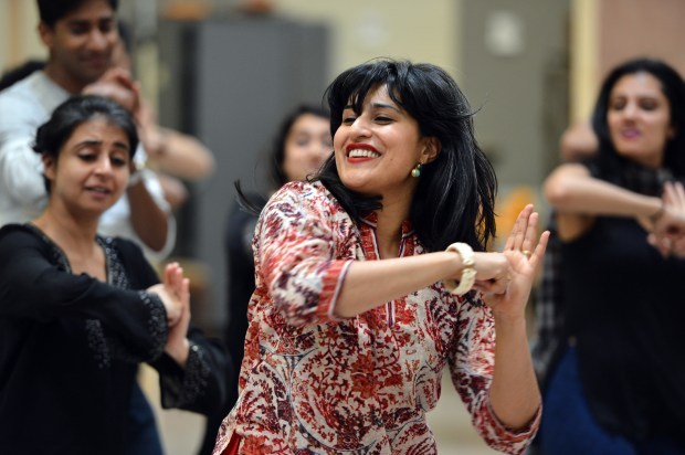 """Assistant Choreographer Namita Kapoor works with the cast during rehearsal for Berkeley Repertory Theatre's upcoming production of """"Monsoon Wedding"""" at their rehearsal space in Berkley, Calif. on Thursday, April 20, 2017. The musical, based on the movie of the same name, will have its world premiere on May 5. (Kristopher Skinner/Bay Area News Group)"""