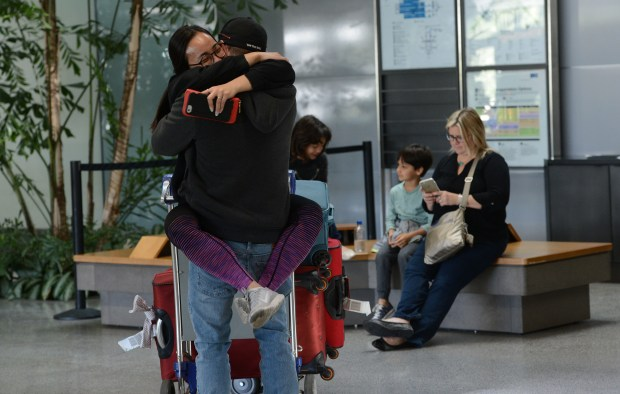 A happy reunion in the international arrival area at San Francisco International Airport in San Francisco, Calif., photographed on Tuesday, April 4, 2017. Have the White House's policies on travel impacted tourism in cities like San Francisco and the Bay Area? Some international travelers may rethink future trips to the United States. (Dan Honda/Bay Area News Group)
