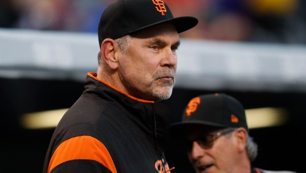 San Francisco Giants manager Bruce Bochy looks on during the first inning of a baseball game against the Colorado Rockies, Friday, April 21, 2017, in Denver. (AP Photo/David Zalubowski)