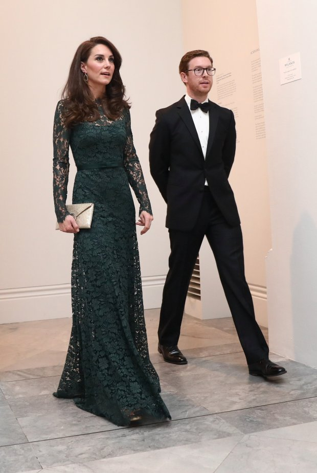 Britain's Catherine, Duchess of Cambridge (L), walks with Nicholas Cullinan Director of the National Portrait Gallery, as she arrives to attend the 2017 Portrait Gala, at the National Portrait Gallery in London on March 28, 2017.The 2017 Gala is fundraising for Coming Home, a project that will make it possible for portraits of iconic individuals to return to places that are special to them for a loan period of over three years. / AFP PHOTO / POOL / NEIL HALL (Photo credit should read NEIL HALL/AFP/Getty Images)