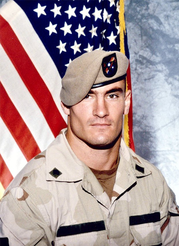 ** FILE ** Former Arizona Cardinals football player Pat Tillman, is shown in a June 2003 file photo, released by Photography Plus. Investigators probing the friendly fire death in Afghanistan of former football star Pat Tillman found no criminal negligence, a government official said Monday, March 26, 2007. (AP Photo/Photography Plus via Williamson Stealth Media Solutions, FILE) ** NO SALES **