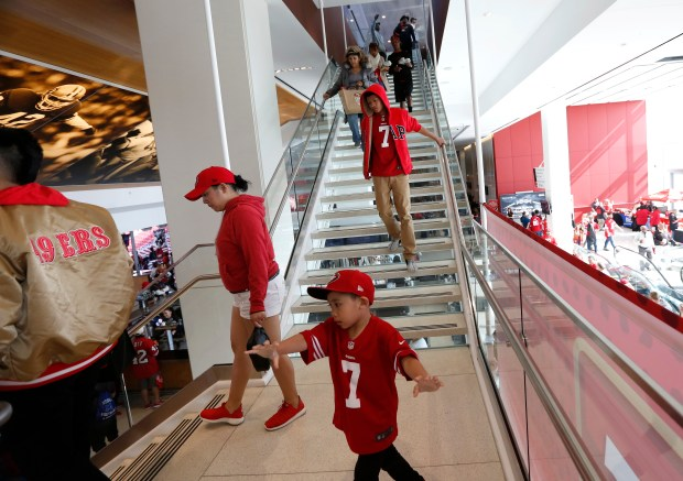San Francisco 49ers' fans walk down a staircase during a draft party for the 2017 NFL Draft at Levi's Stadium in Santa Clara, Calif. on Thursday, April 27, 2017. (Nhat V. Meyer/Bay Area News Group)