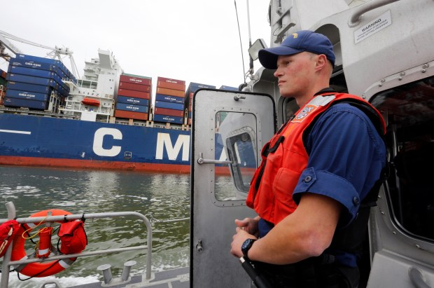 Chief Petty Officer John Skinner from Coast Guard Sector San Francisco patrols the Port of Oakland with a small boat crew of four along the Oakland-Alameda Estuary in Oakland, Calif., on Tuesday, April 11, 2017. (Laura A. Oda/Bay Area News Group)