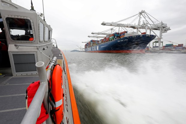 A small boat crew from Coast Guard Sector San Francisco patrols the Port of Oakland along the Oakland-Alameda Estuary in Oakland, Calif., on Tuesday, April 11, 2017. (Laura A. Oda/Bay Area News Group)