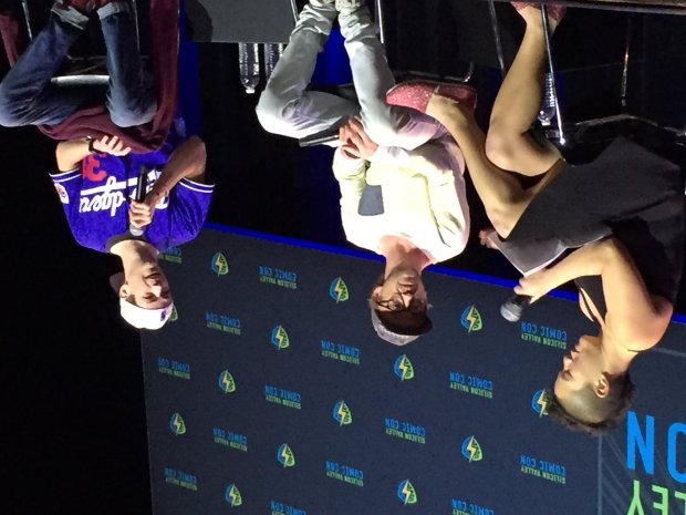 "Grant Gustin, right, star of ""The Flash"" on the CW, received a rush of booswhen he showed up wearing Los Angeles Dodgers gear at his Silicon Valley Comic Con panel with co-star Tom Felton, center, and moderator Dana Han-Klein of Google. (Sal Pizarro/Staff)"