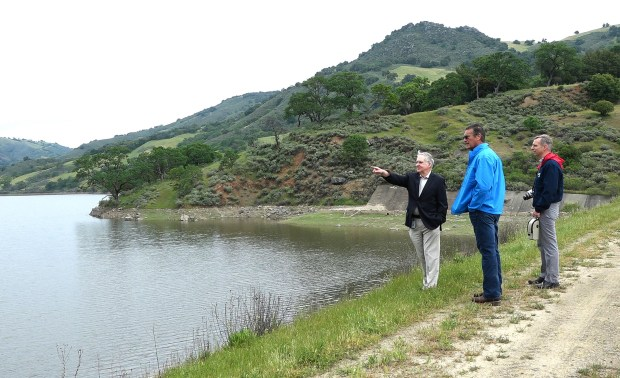 Water officials Garth Hall, Jeff Cattaneo and Marty Grimes, left to right, look over the site of a planned $800 million reservoir in the hills of Eastern Santa Clara County near Hollister, Calif., on Tuesday, April 11, 2017. The reservoir would hold 130,000 acre-feet of water, making it the largest reservoir in Santa Clara County. Hall and Grimes represent the Santa Clara Valley Water District. Cattaneo represents the San Benito Water District. (Gary Reyes/ Bay Area News Group)