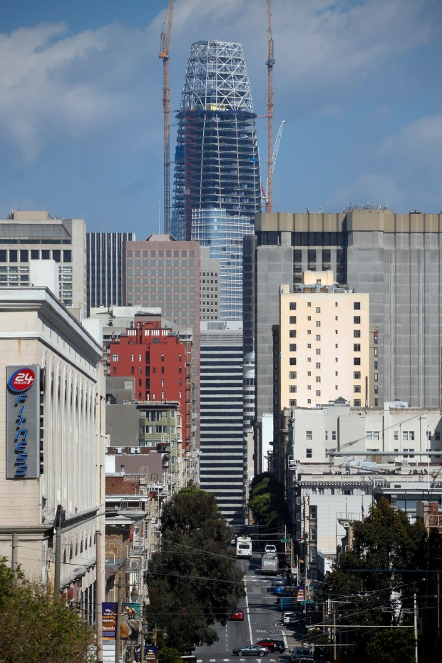 The new Salesforce Tower, San Francisco's tallest building and the second tallest building west of the Mississippi, rises up 970 feet tall along the city's skyline in a view down Post Street. (Karl Mondon/Bay Area News Group)