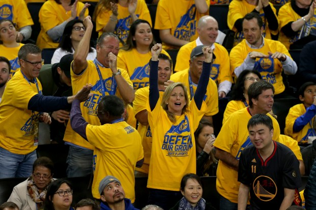 Golden State Warriors fans celebrate a basket against the Portland Trail Blazers in the first quarter of Game 2 of their NBA first round playoff series at Oracle Arena in Oakland, Calif., on Wednesday, April 19, 2017. (Ray Chavez/Bay Area News Group)