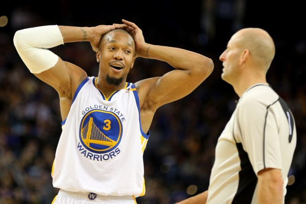 Golden State Warriors' David West (3) reacts after an official called a foul against him on a drive by Dallas Mavericks' Seth Curry (30) in the second half of a NBA game at Oracle Arena in Oakland, Calif., on Friday, Dec. 30, 2016. (Ray Chavez/Bay Area News Group)