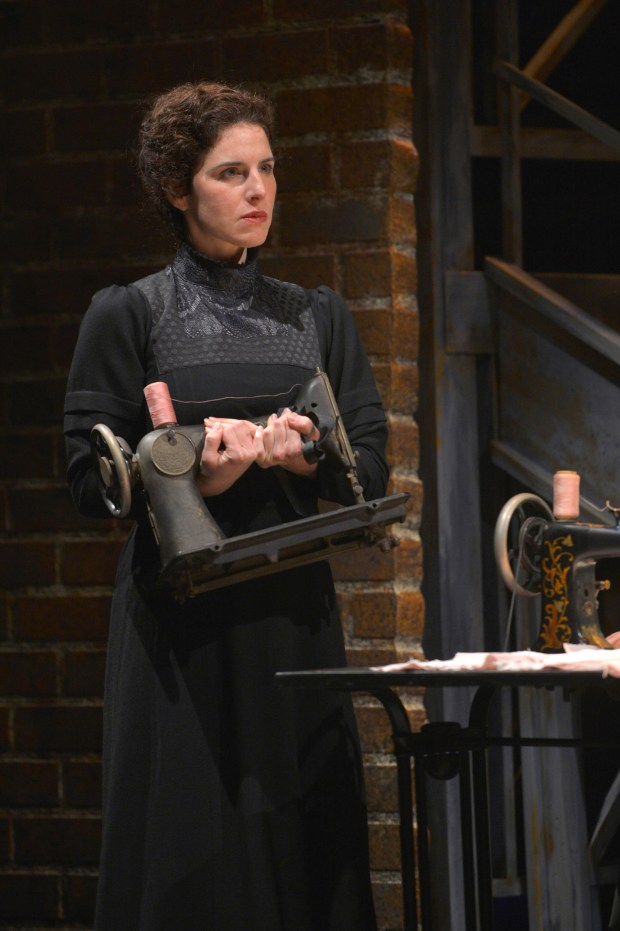 """Kyra Miller as Rebecca takes her sewing machine in TheatreWorks Silicon Valley's """"Rags,"""" a musical saga of immigrant America. (Kevin Berne / TheatreWorks Silicon Valley)"""