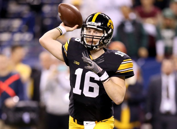 INDIANAPOLIS, IN - DECEMBER 05: C.J. Beathard #16 of the Iowa Hawkeyes passes against Michigan State in the Big Ten Championship at Lucas Oil Stadium on December 5, 2015 in Indianapolis, Indiana. (Photo by Andy Lyons/Getty Images)