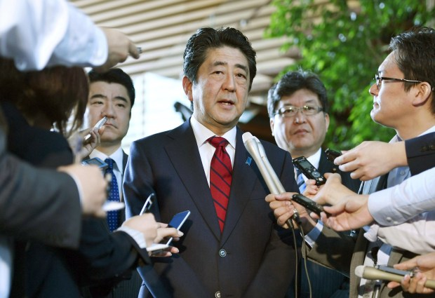 Japanese Prime Minister Shinzo Abe, center, answers to a reporter's question about North Korea's missile launch, at his official residence in Tokyo Monday morning, May 29, 2017. North Korea on Monday fired an apparent ballistic missile off its east coast that landed in the waters of Japan's economic zone, South Korean and Japanese officials said, the latest in a string of recent test launches as the North seeks to build nuclear-tipped ICBMs that can reach the U.S. mainland. (Muneyuki Tomari/Kyodo News via AP)