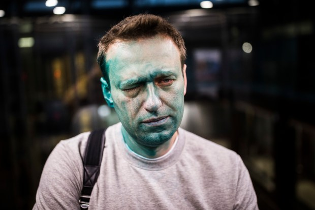 April 27, 2017: Russian opposition leader Alexei Navalny after unknown attackers doused him with green antiseptic. (Evgeny Feldman/Pool Photo via AP)