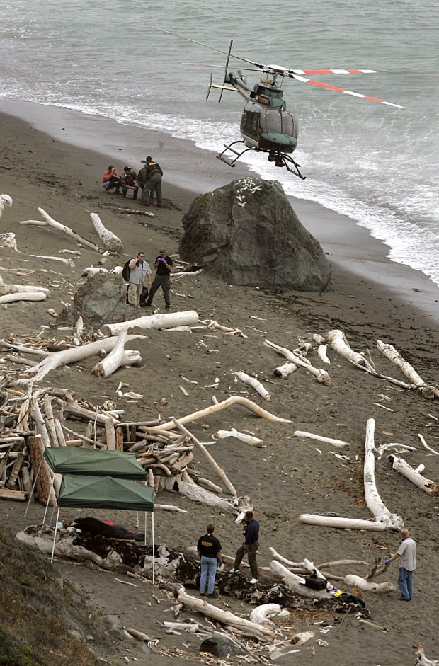 2004 photo: A Sonoma County Sheriff's helicopter drops off personnel and materials at Fish Head Beach, north of Jenner, Calif.,  where two dead bodies in sleeping bags were discovered.  (AP Photo/Santa Rosa Press Democrat, Christopher Chung )
