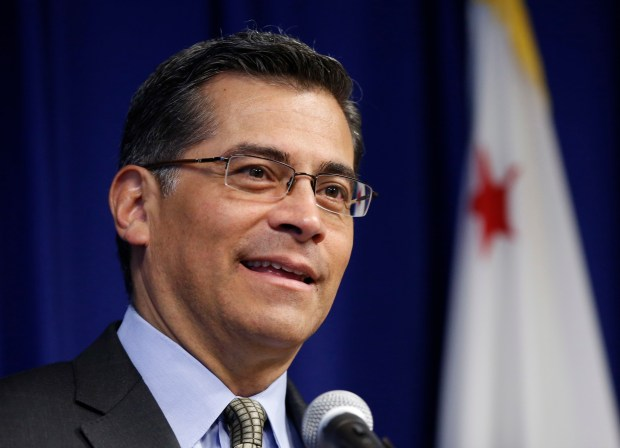 California Attorney General Xavier Becerra speaks at a news conference Wednesday, May 3, 2017, in Sacramento, Calif. Becerra said that he plans to target political nonprofit organizations that he said mislead donors and influence campaigns. (AP Photo/Rich Pedroncelli)