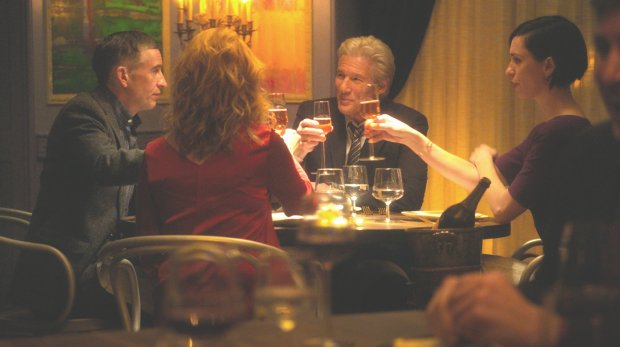 """Steve Coogan, left, Richard Gere and Rebecca Hall in """"The Dinner."""" (TheOrchard)"""