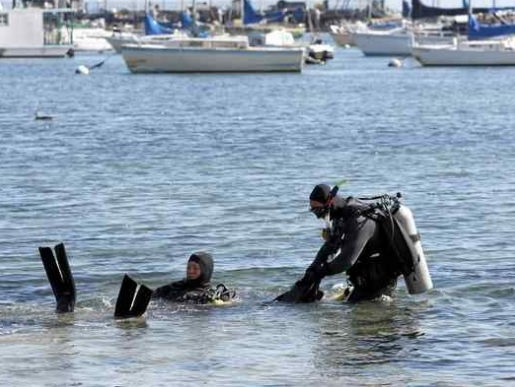 The FBI conducts an underwater training exercise near Fisherman's Wharf in Monterey on Wednesday. (Vern Fisher - Monterey Herald)