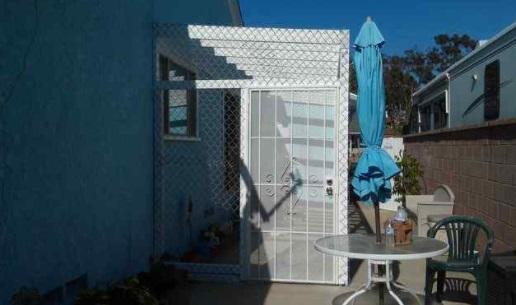 Dana Davis built a coyote-proof patio enclosure for her dog Sophie. (Credit Dana Davis)